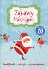 Zabawy z Mikołajem Łamigłówki, naklejki, gra planszowa Praca zbiorowa
