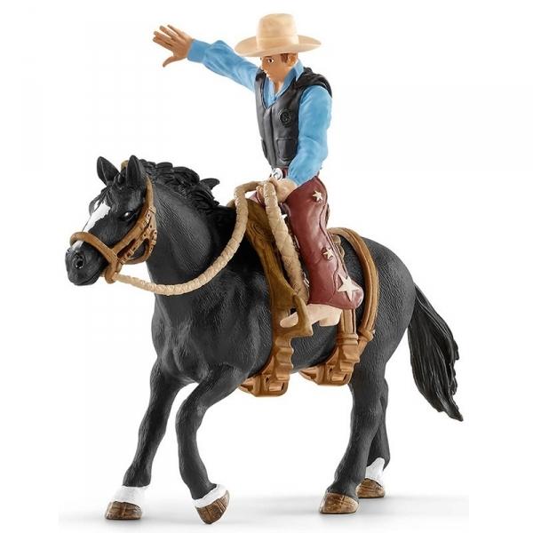 Kowboj siodłający dzikiego konia - 41416