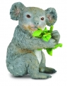 Miś koala jedzący liście eukaliptusa M (004-88357)